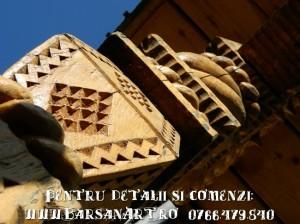 Coloana sculptata a unei porti maramuresene